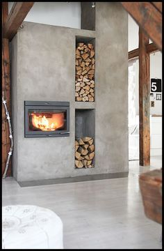 concrete-fireplace-with-firewood-storage - Home Decorating Trends - Homedit Concrete Fireplace, Home Fireplace, Fireplace Design, Concrete Wood, Farmhouse Fireplace, Fireplace Hearth, Modern House Design, Modern Interior Design, Interior Architecture