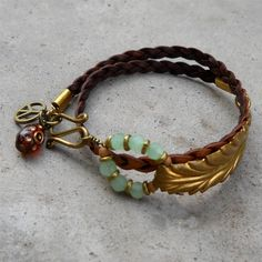 Vintage leaf genuine Greek braided leather wrap bracelet with peace sign and evil eye bead. $49.00, via Etsy.