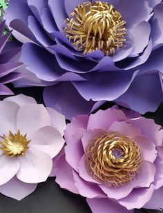 2 sets of paper flower corner arrangement: in shades of purple, gold, cream and pink with green foilage. 2 - Extra large paper flower 2 - Large paper flower 2 - Medium paper flower 8 - small paper flowers 20 - leaf vines If you want 1 set of this listing, please visit the link