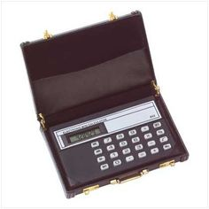 """Mini Briefcase Calculator Vinyl Business Card Holder by Furniture Creations. $8.47. 4 1/2"""" x 2 3/4"""" x 3/8"""" high. Ingeniously detailed mini briefcase holds a calculator and business cards. Vinyl case. 4 1/2"""" x 2 3/4"""" x 3/8"""" high."""