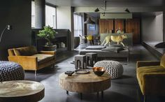 Ochre velvet sofa's, Jan Van Eijck poofs, Serge Mouille suspended lamp, Eames chairs, what's not to love about this great mix of contemporary and Mid Century design - via photographer Ricardo Labougle