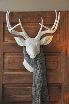 Love the scarf and the stag mounted on the door.
