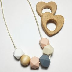 junebug teething necklace - handmade teething jewellery and accessories for babies. elephant shoe teething co. offers teething necklaces, teething bracelets, soother clips, teethers and onesies. Stylish and safe for mamas and babies.