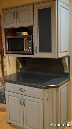 I bet I could do this to the right of the fridge.  I'd need to find the same color stain as the original cabinets, but I bet I could figure it out!!
