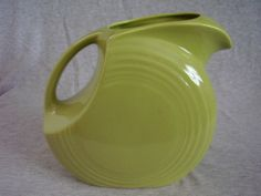 Checkout this amazing product Vintage Fiestaware Chartreuse Large Disk Water Pitcher at Shopintoit