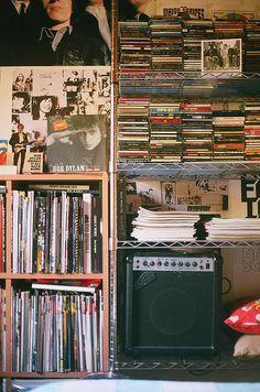 cute indie bedroom with amp & vinyl records on bookshelves