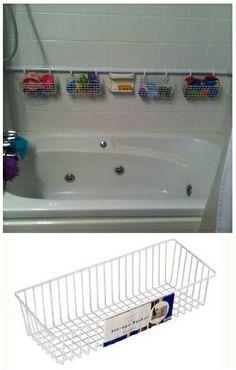 Shower rod, Shower hooks & wire storage basket creates Bath Toy Tub Storage Solution. GENIUS!!!!!!!!!!!!!