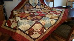 Looking for quilting project inspiration? Check out Ellie's Christmas Quilt by member kwiltinginny. Finished with techniques from Quilting Big Projects on Small Machine on Craftsy.