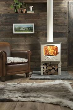 The Country Living Bembridge wood-burning stove by Charnwood is now available to order in a stylish selection of five colours. Wood Stove Hearth, Stove Fireplace, Fireplace Design, Fireplace Ideas, Best Wood Burning Stove, Log Burning Stoves, Living Tv, Living Rooms, Casa Loft