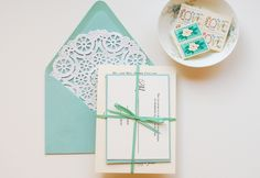 Tiffany blue?  Color (one or several) just on the boarder and with ribbon & envelope?