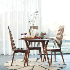 Parker Mid-Century Round Dining Table | West Elm Miac Whirlwind Rug Spoke Dining Chair