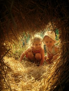 We will build hayforts in the barn's loft.  (I have LOTS of experience).  These two hayseed contractors are Miley Emmaline & her baby brother, Blake Harlan, who will both soon have rashes on their elbows & knees.