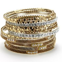 """Chamak by Priya K Metallic Bangles Fun and flirty bangles that let you play and sparkle in an array of metallics in gold and silver tones with beautiful crystals. 12 bracelets to play around and mix and match. 2.5"""" in diameter. Never worn and purchased on Gilt. Comes in it's original gift pouch. Chamak by Priya K Jewelry Bracelets"""