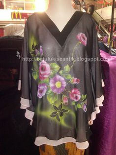 Beautiful dress with hand-painted decoration