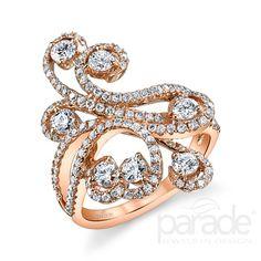 Swirls of brilliant-cut round diamonds sparkle among glowing 18K rose gold.