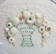 This is beautiful!  I love the buttons and old linens, will do something similar but recreated on clothing most likely.  White Shabby Cottage Vintage Button Art by NorCross