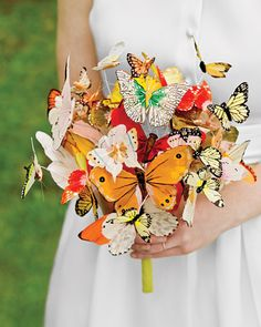 Bride Laura Normandin fashioned her breathtakingly beautiful butterfly bouquet from silk and feather creatures secured on thin wires so that they float and flutter realistically.