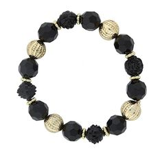 Featuring a row of black beads in various shapes and textures with gold-toned bead accents for contrast.