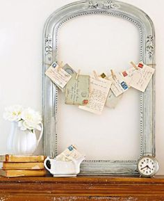 Old handwritten letters are strung across an empty frame with jute twine to create a pretty vintage vignette. | Midwest Living