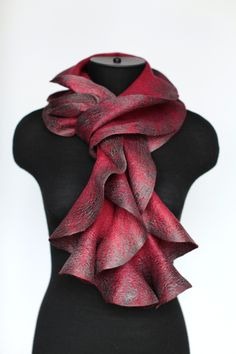 Scarf designed and made by Marina Shkolnik, a self-taught designer from Moscow, using a technique called nuno felting.  Nuno felting is a fabric felting technique developed by Polly Stirling, a fiber artist from New South Wales, Australia, around 1992.  The technique bonds loose fibre, usually wool, into a sheer fabric such as silk gauze, creating a lightweight felt.