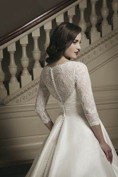 Style #8695 features delicate lace sleeves for the traditional style bride I @Justin Dickinson Dickinson Alexander I http://www.weddingwire.com/wedding-photos/dresses/justin-alexander/i/61a4ef4fbfd53b7c-dafb754575744920/76bfe3e2cb44654a