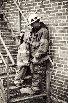 love this shot of a firefighter and his son.  from the looks of it, he wants to follow in daddys footsteps.