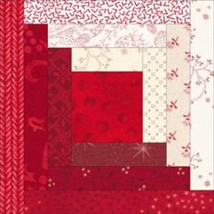 Log Cabin quilt block with a large center patch