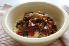 1 cup uncooked millet vegetable broth, optional 2 tablespoons extra virgin olive oil ½ medium onion, chopped 1 zucchini, cut in half lengthwise then sliced ½ eggplant, chopped 2 very ripe medium tomatoes 3 cloves of garlic, chopped 1 tablespoon tomato paste 1 teaspoon cumin 1 teaspoon smoked paprika pinch of cayenne pepper pinch of...