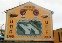 Loyalist Mural Depicting The Release Of Ulster Defence Association & Ulster Freedom Fighter Prisoners Of War . Northern Ireland Troubles, Prisoners Of War, Freedom Fighters, Belfast, Wall Murals, Wallpaper Murals, Murals, Wall Prints, Mural Painting