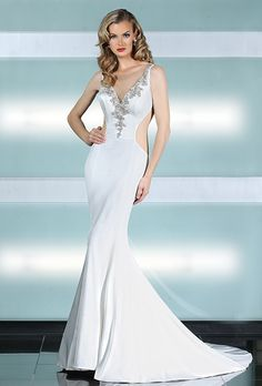 Brides: Simone Carvalli. A sophisticated sheath gown features beaded embellishment trim along a plunging illusion neckline, with a beaded illusion tulle back completing the look.
