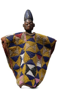 Africa | Ibeji figure with beaded cape from the Yoruba people of Nigeria | Wood, cloth, glass beads