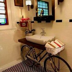 Bike under the sink. Such a cool idea for a guest cloakroom.
