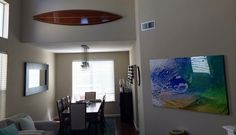 decorative wooden surfboard above opening; nautical decorative touches