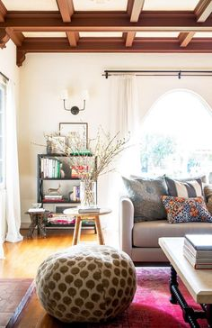 Love this boho chic family room - pink rug is the perfect colorful layering piece