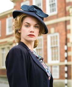 #woman in #40s fashion style. She has a strand look in her eyes. She might be nice to be a character for The Giant Heart