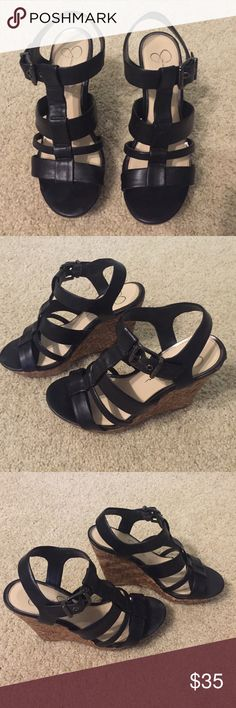 Jessica Simpson black wedges in size 7.5 Jessica Simpson black wedges size 7.5. Beautiful black wedges with cork wedge heel roughly 4-5 inches. Buckled ankle for additional comfort and sizing. Only worn 1-2 times; In amazing condition! Jessica Simpson Shoes Wedges