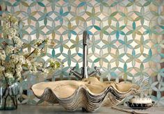 Fiona, a jewel glass waterjet mosaic shown in Aquamarine and Dawn Mirror, is part of the Silk Road Collection by Sara Baldwin for New Ravenna Mosaics.