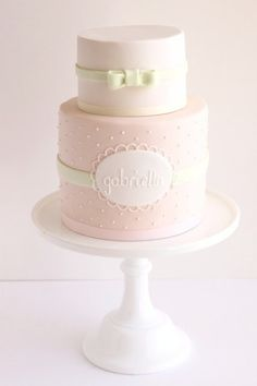 girl baby shower cake - darker pink with polka dots and use name Lauren on the tag