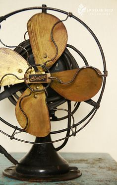 Love vintage fans, especially this mix of wood and metal.