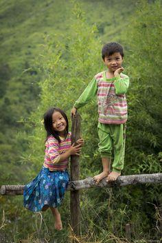 Childhood innocence by Nguyen Ba Quang Hai.  Two ethnic children in Quan Ba, Ha Giang.