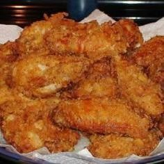 Crispy Fried Chicken Wings - Chicken wings marinate in buttermilk before being pressed into a cayenne-, garlic-, and thyme-spiked cracker br. Crispy Fried Chicken Wings, Fried Chicken Recipes, Baked Chicken, Chicken Gravy, Black People Fried Chicken Recipe, Garlic Chicken, Roasted Chicken, Chargrilled Chicken, Snacks