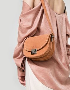 From Loeffler Randall, a classic shoulder bag in Desert Nude. Featuring a leather construction, main compartment with flap and push-lock closure, interior zip pocket, silver-toned hardware and adjustable shoulder strap with pin closure.  • Shoulder bag