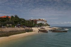 Stone Town's waterfront Stone Town, Alleyway, Old Buildings, East Africa, River, Explore, Adventure, Mansions, House Styles