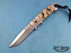 Sub-Hilt Chute by Dietmar Kressler. This knife has great color Rams Horn with a grey-tan shade.  Blade Length: 4 inches  Overall Length: 8 1⁄2 inches  Blade Steel: BG-42 SteelHandle Material: Rams Horn