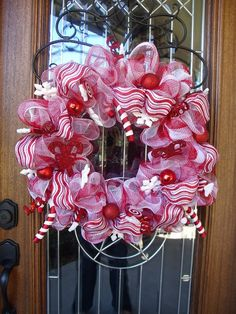 Items similar to Candy Cane Mesh Wreath on Etsy. , via Etsy.
