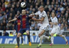 Andres Iniesta and Pepe compete for possession