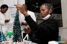 A woman paints on ceramic beads at the Kazuri factory in Nairobi.