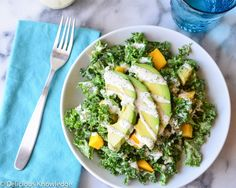Kale salad with creamy, vegan poppyseed dressing, mango and avocado. If you don't think you like kale, try this one! Even kale haters love it!