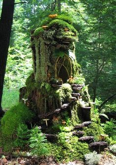 "Moss Faerie House ~ by Sally J. Smith (Lake Champlain, NY) -- www.greenspiritarts.com -- ""Here you will find magical visions of Faerie Houses made from real leaves, moss and stone (and many other natural materials) as well as the stunning sculptures the artist calls ""Eartherials"" which echo the beauty of a special place or moment in time."""