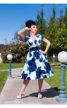 Pinup Couture- Birdie Dress in Vintage Blue Rose  The Birdie Dress in Vintage Blue Rose is a full skirted, vintage-style party dress with a wide, notched collar creating a classic, polished silhouette. Finished off with a side zipper and wide vinyl belt. In white sateen with Pinup Couture's exclusive vintage blue floral print, this dress is a real head-turner! - See more at: http://www.pinupgirlclothing.com/birdie-blue-rose.html#sthash.CkHQ1WRs.dpuf